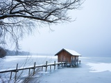 Snow covered pier and boat house at Lake Starnberg Photographic Print by Frank Lukasseck