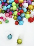 Christmas ornaments on snow Photographic Print by Pauline St. Denis