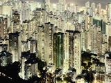Hong Kong skyscrapers and apartment blocks at night Photographic Print by Martin Puddy