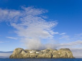 Morning Fog Over Small Rocky Island at South Shetland Islands Photographic Print by John Eastcott & Yva Momatiuk