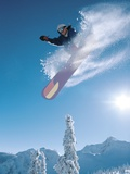 Man snowboarding on sunnny day Photographic Print by Henry Georgi