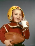 1950s 1960s Boy Drinking Glass Milk Wearing Football Helmet Shoulder Pads Photographic Print by H. Armstrong Roberts