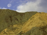 Full moon setting over mountain in Kluane National Park Photographic Print by John Eastcott &amp; Yva Momatiuk