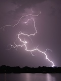 Lightning Striking Ground Near Residential Lake Photographic Print by Jim Reed