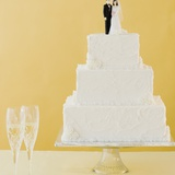 Wedding cake toppers on cake Photographic Print by Jamie Grill