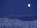 Moonrise over Glacier National Park from The Big Mountain ski area Photographic Print by Gordon Wiltsie