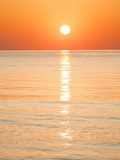 Sunlight Reflecting on Ocean at Sunset Photographic Print by Frank Lukasseck