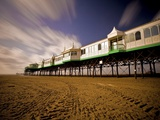 Pier at Lytham St. Annes extends over a sandy beach Photographic Print by Phil Norton
