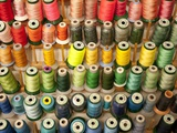 Multi-colored thread in high school sewing class Photographie