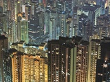 Apartment buildings in Hong Kong at night Photographic Print by Rudy Sulgan