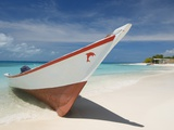 Fishing boat on beach in Los Roques Archipelago National Park Photographic Print by Richard Broadwell