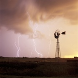 Lightning Striking Amid Farmland Photographic Print by Eric Swanson