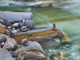 Small stone cairn on striated boulder in the Verzasca River Photographic Print by Frank Krahmer