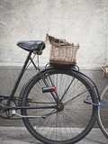 Bicycle with weathered basket Photographic Print by Jenny Elia Pfeiffer