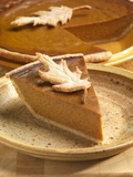 Slice of Pumpkin Pie with Pastry Leaf Garnish Photographic Print by Paul Poplis