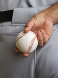 Close up baseball pitcher holding baseball behind back Photographic Print