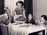 Mother serving a turkey on a platter Photographic Print
