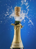 Close up of champagne cork popping Photographic Print