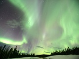 Aurora Borealis or Northern Lights, Yukon. Photographie par Robert Postma
