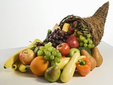Fruits and vegetables in cornucopia basket Photographic Print