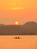 Father and daughter fishing at sunset near Lewolin Village Photographic Print by Stuart Westmorland