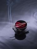 Burning incense on top of bowl of petals Fotodruck von John Smith