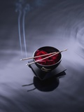 Burning incense on top of bowl of petals Photographic Print by John Smith