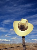 Cowboy Hat on Barbed Wire Fence, British Columbia, Canada Photographic Print by Gary Fiegehen