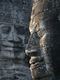 Cambodia Siem Reap Bayon Temple Carved face Photographic Print by Paul Seheult