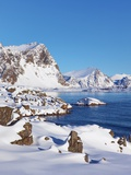 Coastal mountains in the Lofoten Islands in new snow Photographic Print by Frank Krahmer