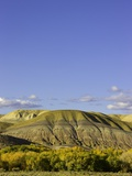 Sandstone buttes and cottonwoods in fall in Wyoming Photographic Print by John Eastcott & Yva Momatiuk