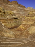 Colorful sandstone layers of The Wave at Coyote Buttes Photographic Print by John Eastcott &amp; Yva Momatiuk