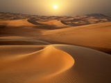 Intense Sun over sand dunes around Dubai Fotoprint van Jon Bower