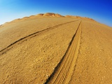 Tire tracks in the sand Photographic Print by Frank Krahmer