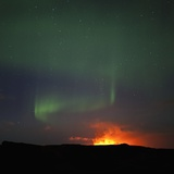 Aurora Borealis over eruption at Eyjafjallajokull glacier Photographic Print