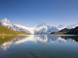 Wetterhorn , Schreckhorn and Finsteraarhorn reflecting in Lake Bachalp Photographic Print by Frank Lukasseck