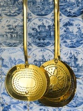 Brass strainers hanging on a tile wall Photographic Print by Nathan Benn