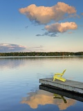 Clouds reflected in Silent Lake with Muskoka chair on dock Photographic Print by Mike Grandmaison