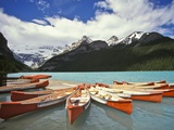 Canoes on Lake Louise Photographic Print by Richard Nowitz
