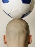 Man with soccer ball on head, rear view, close-up Photographic Print by Loop Delay