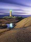 Peggy&#39;s Cove Lighthouse, Nova Scotia, Canada. Photographie par Darwin Wiggett