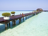 Boardwalk and bungalow by a lagoon in the Maldives Photographic Print by Frank Lukasseck