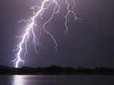 Lightning Striking Ground Near Residential Lake Fotografie-Druck von Jim Reed