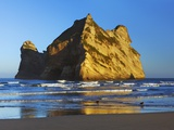 Rock formation off Wharariki Beach in New Zealand Photographic Print by Frank Krahmer