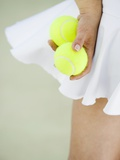 Woman Holding Tennis Balls Photographic Print by Duane Osborn