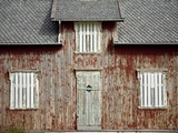 A Weathered, Once Red, Home on the Island of Vaeroya Photographic Print by Ira Block