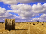 Bales and Clouds Near Sherbrooke, Saskatchewan, Canada. Fotoprint van Mike Grandmaison