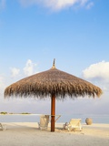 Beach chairs and umbrella at the beach Photographic Print by Frank Lukasseck