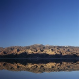 Brown Hills Reflected in a Lake Photographic Print by Micha Pawlitzki