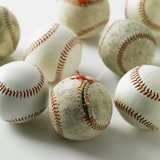 Old and new baseballs gathered together Photographic Print